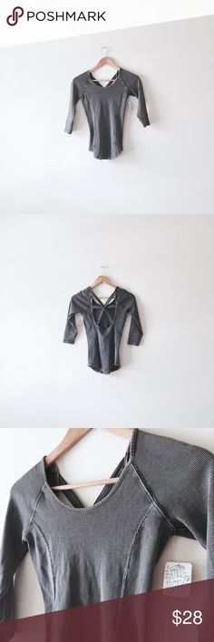 Free people cross back thermal Size XS. NWT. Faded gray color. Cross back design. Three quarter sleeves. Fits true to size. Free People Tops Tees - Long Sleeve