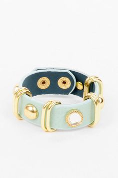 """Bijoux: Rocks and Studs Bracelet - $12    Faux leather bracelet with gold-plated fixtures and studs  Imported  Color: Mint  Snap-button closure  .75"""" wide  8.5"""" long"""