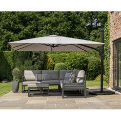 A Norfolk Leisure Norfolk Deluxe square cantilever parasol finished with a powder coated aluminium frame and a taupe canopy. x Sturdy powder coated aluminium frame base parts) 360 degree rotation Will tilt front to back Backyard Garden Design, Patio Design, Backyard Patio, Garden Parasols, Garden Canopy, Shade Umbrellas, Patio Umbrellas, Parasol Base, Beach Cottages
