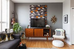 the credenza as a TV stand with vertical art behind it looks great too