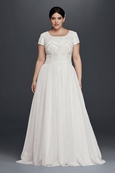 a81e3ffb612 Ethereal tulle elegantly flows out from the attached sash waist band of  this modest