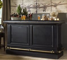 Like this bar, as a DIY project, build a 3 sided box, height x width of said bar, add baseboard trim and plain large picture frames etc. pain black, add accessories like kick rail.