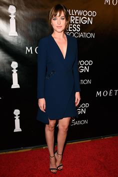 Dakota Johnson chose a navy Dior dress for her appearance at the Grants Banquet on August 13, 2015