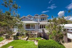 A weatherboard home in the heart of Byron Bay - grey and white exterior colour scheme