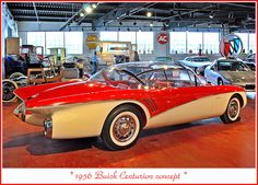 """Buick Automotive Gallery, part of the Sloan Museum in Flint, Michigan.The Buick Centurion was first shown to the public at the 1956 Motorama Show.  The two-door four-passenger coupe was constructed of fiberglass with an all glass top.  Power was from a 325 hp V-8 engine.  A unique feature was a television camera in the rear """"jet port"""", which broadcast an image toa screen in the dashboard, eliminating the rear view mirror."""