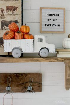 """Cute Fall Mantel, love the Vintage Truck with Faux Pumpkins + Gourds. """"Pumpkin Spice Everything"""" letter board is perfect for this space!"""