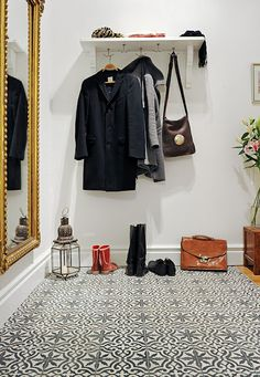 Tiles, mirror, clever wee hooks... oh, and I'll take that satchel and those boots too, please!
