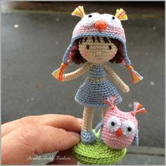 Crocheted dolly wearing an owl hat with an amigurumi owl. (Inspiration).