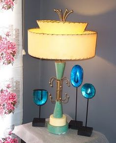 Aqua Deco- Eames Era Lamp. The Eames, God bless their little hearts would be spinning in their graves to know that their names are associated with this horror.