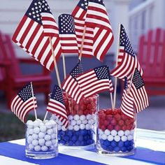 Memorial Day / 4th of July decorations - American flags in glass jars filled with red, white and blue gum-balls.