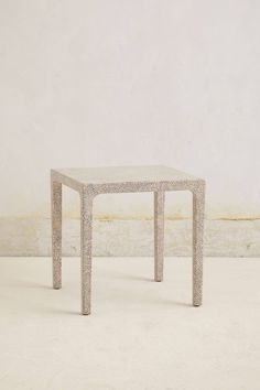 Pressed Pearl Side Table - anthropologie.com - This looks like it could be pretty easy DIY w/ pearls/beads and grout