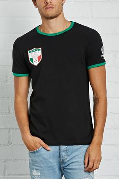 64880152 A knit crew neck soccer tee featuring short sleeves, contrast trim, a Copa  America
