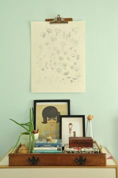 Hang a clipboard to allow for a rotating display of artwork. (Eva Black Design)