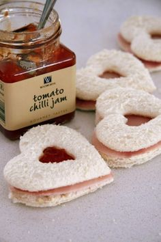 Queen of hearts sandwiches - Make Sandwiches with a layer of ham or turkey, and a layer of tomato jam ( or substitute to your taste). Then using a cookie cutter, cut out your heart shaped sandwiches!