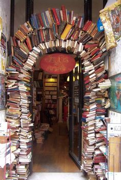 A doorway arch in a library, made of books.