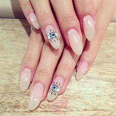 Toronto's boutique nail salon specialized in gel nail art! Find us at  www.getgelled.com  www.instagram.com/getgelled  Almond shape nude nail with evil eye nail art @getgelled