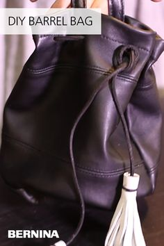 Make a simple barrel bag using recycled leather with this free lesson from #WeAllSew. #leatherbag #sewingproject #sewing