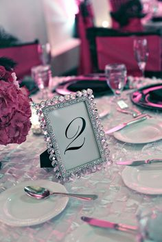 Sparkly picture frames on tables! Put a picture of bride & groom :)