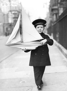 Tommy Sopwith with model of Endeavor, 1937