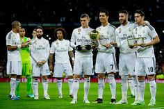 Cristiano Ronaldo of Real Madrid CF poses with his third Golden Ball for a picture surrounded by his teammates prior to start the Copa del Rey Round of 16 second leg match between Real Madrid CF and Club Atletico de Madrid at Estadio Santiago Bernabeu on January 15, 2015 in Madrid, Spain.