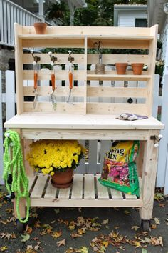 Simple potting bench...I like the hooks and shelves (Diy Pallet Planter)