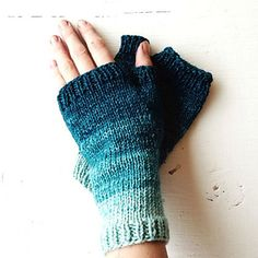 Fingerless mitts knit up with Pigeonroof Studios 240 yard mini-skein sets, so that the colours shade up the mitts.