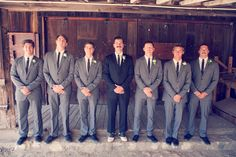 Gray groomsmen and black suit groom. Black Toms shoes or all of them with black dress shoes.
