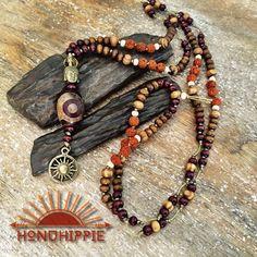 Large Dzi bead buddha sun symbol necklace, yoga mala meditation jewelry by HonuHippie on Etsy https://www.etsy.com/listing/451028318/large-dzi-bead-buddha-sun-symbol