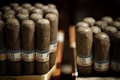 Kinda wish I smoked cigars so I could have a box of these purty things on display in my apartment: Cohiba Cabana Cigars.