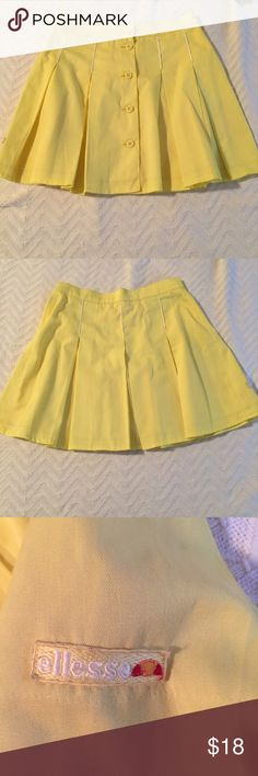 Yellow pleated mini skirt Very flirty and cute. Ellesse Skirts Mini