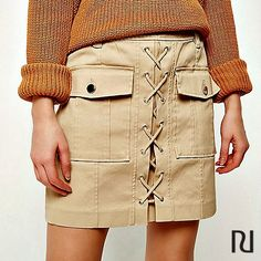 Meet the skirt of the season! Our beige lace-up utility mini skirt $60