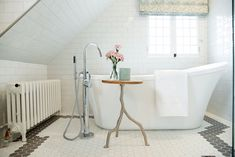 Simple bathroom design + side table in bathroom + freestanding tub + floor-mount tub faucet + attic bathroom design + slanted roof in bathroom + girls bathroom + small bathroom design + custom tile + hexagon tile pattern + white and beige tile Girl Bathrooms, Small Bathroom, Attic Bathroom, Simple Bathroom Designs, Sink Design, Farmer's Daughter, White Tiles, Bath Remodel, Tile Patterns