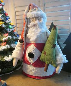 PRIMITIVE Folk Art Christmas SANTA made from Antique QUILT - on Rusty Spring
