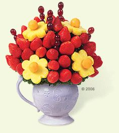 Make a fruit bouquet for Mom!   Pineapple slices...cantaloupe...strawberries...grapes...Happy Mother's Day!