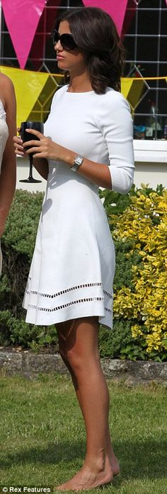 Simple and stylish: Lucy opted for a chic white skater dress for the party, keeping her look low key