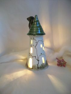 Fairytale Tower - Rapunzel - Night Light - Fairy House - Wheel Thrown - Made to Order. via Etsy. Ceramic Lantern, Tower Design, Fairy Garden Houses, The Potter's Wheel, Pottery Sculpture, Slab Pottery, Flowering Vines, Light Project, Hanging Tapestry