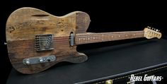 This guitar is a beauty with that natural wood finish!