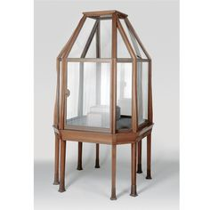MARTIN DÜLFER, EXECUTED BY HOFMÖBELFABRIK J.A. EYSSER, BAYREUTH A DISPLAY CABINET mahogany clad metal frame with original glass and bronze sabots, opening to one side, made for the Louisiana Purchase Exposition, St. Louis 1904 109cm. wide (approx.); 3ft. 7in. Munich, circa 1903