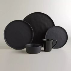 Crafted in Portugal of stoneware in a sleek, organic shape, our black dinner plates feature unique rimmed lips for a modern look. Pair them with your existing dinnerware, or set a complete table with our full collection. Ceramic Plates, Ceramic Pottery, Assiette Design, Keramik Vase, Affordable Home Decor, World Market, Decoration Table, Plate Sets, Matte Black