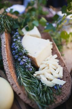 Wonderful, natural wood for serving cheese and rosemary sprigs.