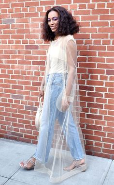 2af3b5924a9d2 Solange Knowles from Best Celeb Street Style From NYFW Spring 2017 An easy  way to dress up your go-to denim  Throw sheer layer over top just like  Bey s baby ...