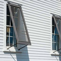 Bahamas-style hurricane shutters from Southern Traditions Window Fashions add architectural charm to our All-American Cottage. | Photo: Fred Rollison | thisoldhouse.com