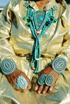 What an amazing picture! First her amazing hands.....what stories they must hold. Second is the color....it's all about the color. Third is my question about what might be the reason for the unusual fabric. (Navajo. Turquoise. Silver. Hands.)