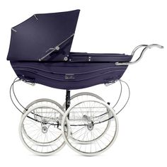 The Silver Cross Balmoral coach-built pram, shown here in navy blue.