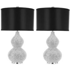These silver beaded table lamps are designed as jewelry for the home with a pear-shaped, silver beaded resin body that is elegant while making a statement. The black cylinder satin shades complete the look that is perfect in just about any room.