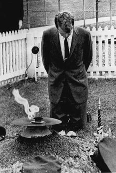 Bobby Kennedy praying at his brothers grave.