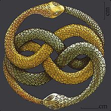 My absolute favorite movie as a child: The NeverEnding Story. A description of the film on Wikipedia says AURYN, this symbol, the original prop is now kept in Steven Spielberg's office.