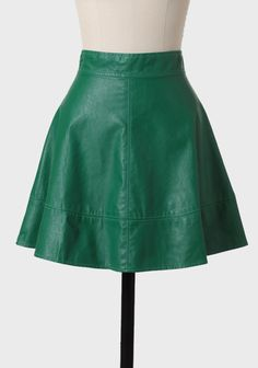 Covington Gardens Faux Leather Skirt 39.99 at shopruche.com. This high-waisted kelly green leatherette skirt features decorative stitching and an exposed back zipper. Pair this vibrant skirt with the blouse of your choice to add a touch of color to your look. Fully lined.Self: 50% PU, 50% Polyester,...