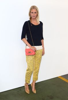 Poppy attended the House of Holland show in a navy blue Paul Smith cable-knit sweater, which she layered with a Rag & Bone top and yellow printed Dolce & Gabbana trousers. We love how she added a pair of gold Manolo Blahnik heels and a pretty