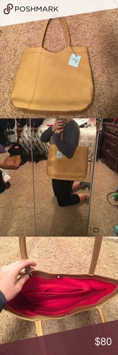 NWT HOBO Tote NWT Gold leather authentic HOBO tote! Never been used, inside is in perfect condition. The only flaw is the gold leather of the handles is ripped on 3 handles. Does not affect the purse however. I believe this happened because the leather is heavy and the handles were are weight down by it. HOBO Bags Totes